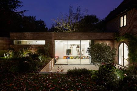 Night view of contemporary brick extension in private garden