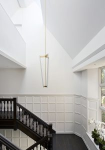 triple height stairwell with contemporary chandelier