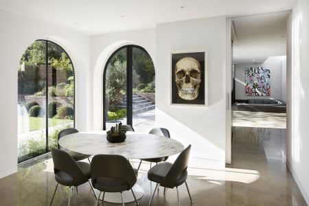 contemporary interior featuring marble table, stone floor and views to garden and extension