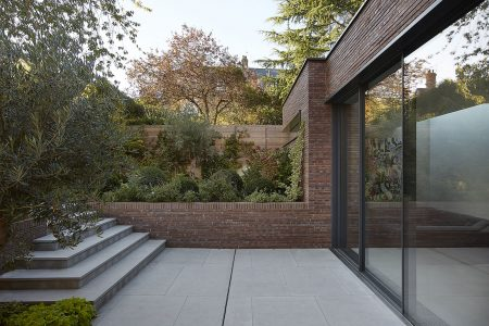 brick extension in lush garden