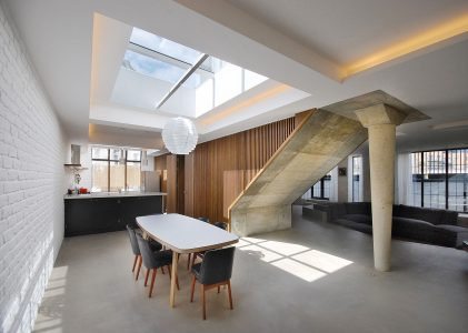 Contemporary interior featuring open plan kitchen, dining and seating area