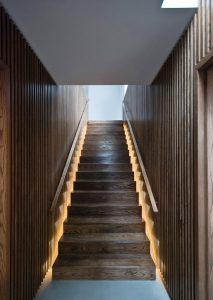 contemporary wooden staircase with concealed lighting