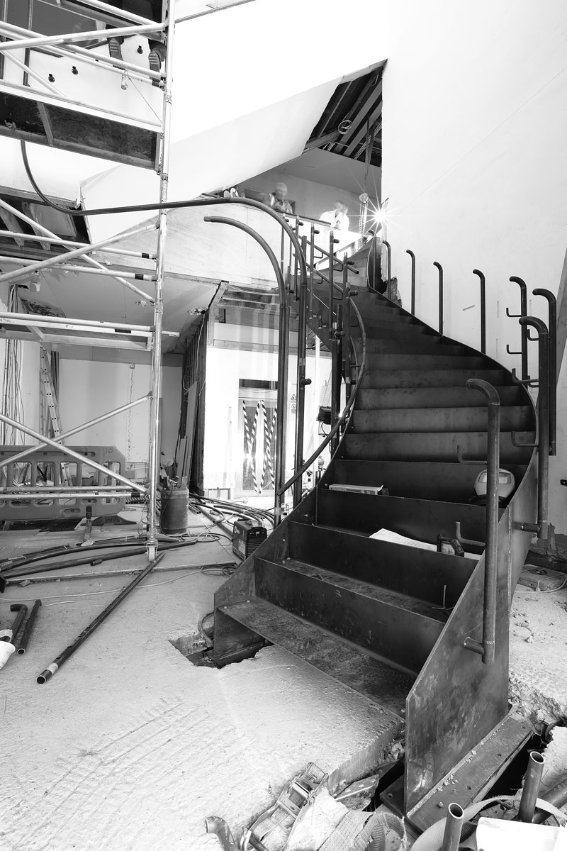 installation of curved steel staircase