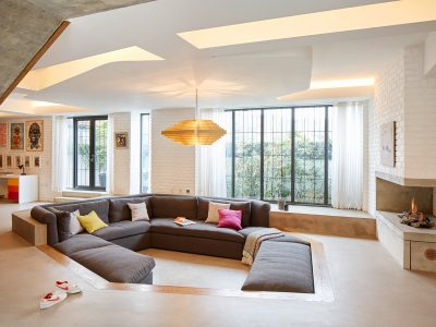contempory living room with bespoke brass chandelier
