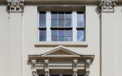 Facade details including Corinthian, capitals and pediment